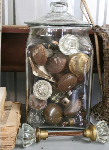 Door knobs in glass apothecary jar